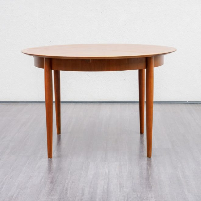 round walnut dining table from lbke 1960s
