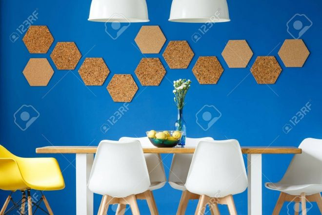 royal blue wall in simple scandinavian dining room with wooden