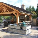 rustic covered outdoor kitchen with bar hgtv outdoor