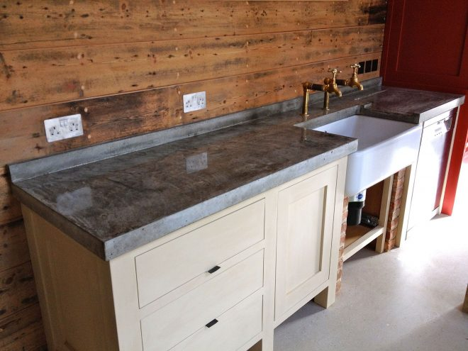 rustic kitchen with wooden backsplash and concrete