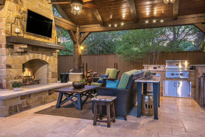 rustic outdoor living space with outdoor kitchen texas
