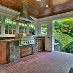 rustic porch with pathway screened porch outdoor kitchen