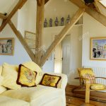rustic wooden beams and apex ceiling in country living room