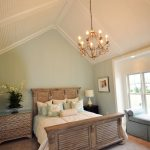 seaside master bedroom with vaulted ceiling with low profile