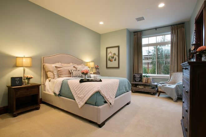secondary bedroom with large window base interior design
