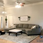 sherwin williams agreeable gray in living room with gray sectional