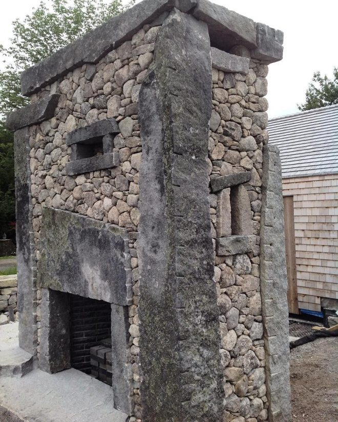side view or outdoor fireplace stones stone stonewall