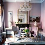 small and romantic living room with soft pink wall panit mirror