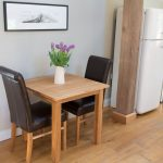 small kitchen table and leather chair set in yorkshire barn from top