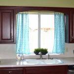 soft turquoise curtains on the small white kitchen window refresh