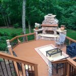 stone outdoor fireplace and deck archadeck and stain renew