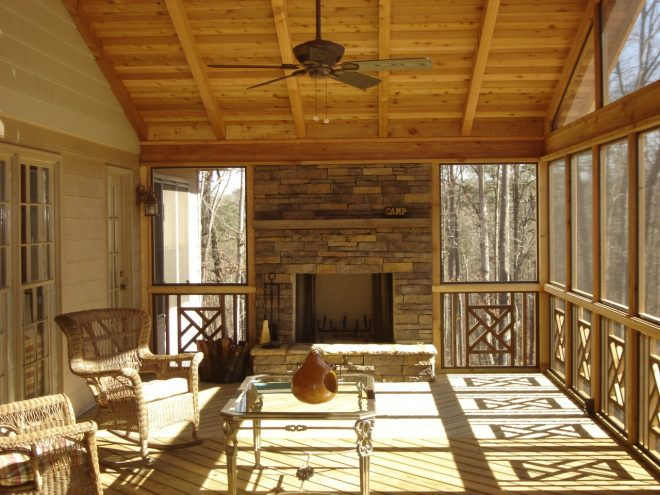 stone outdoor fireplace on screened porch archadeck