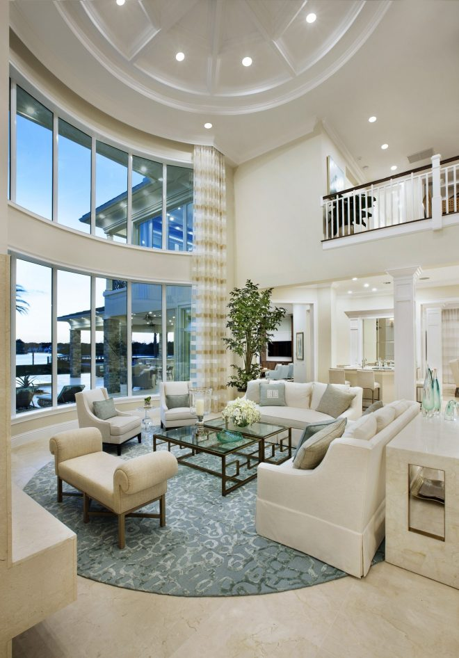 stunning floor to ceiling windows in this gorgeous two story living