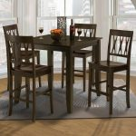 style 19 small counter height table and wood chairs