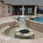 sunken outdoor kitchen and fire pit with lazy river pool in