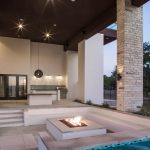 sunken outdoor seating area with modern concrete fire pit hgtv