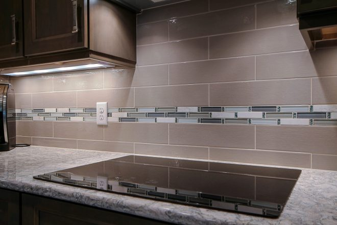 taupe subway tile with glass accent mosaic kitchen remodel