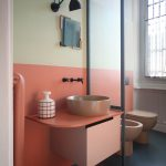 the bathroom paint colors in this apartment are a winning