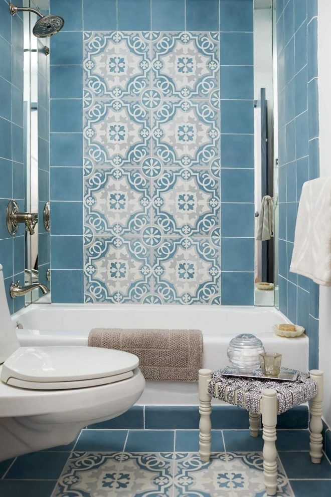 the custom cement tiles in this blue bathroom give it