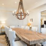 the more formal dining room has a natural wood slab table