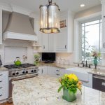 the painted white durasupreme kitchen cabinets create a bright