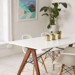 the saints dining table is a sleek mid century modern dining