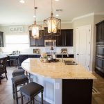 the unique curved kitchen island provides extra casual seating in