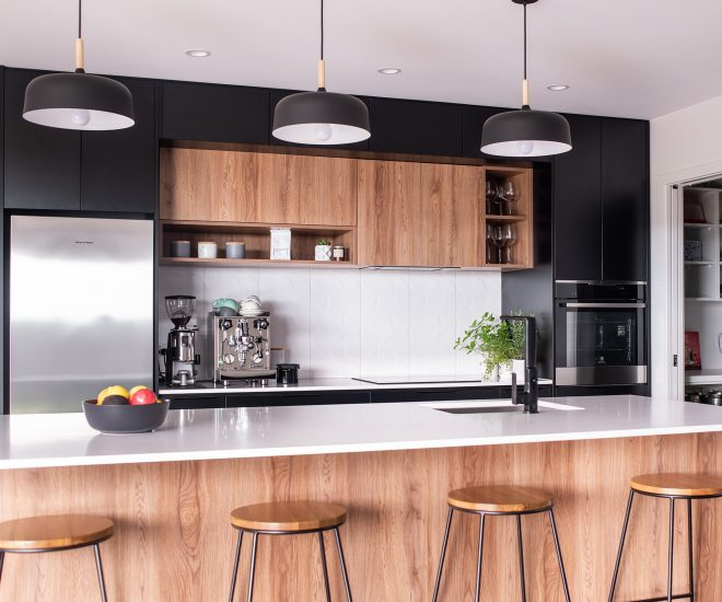 this black and white kitchen was designed for entertaining