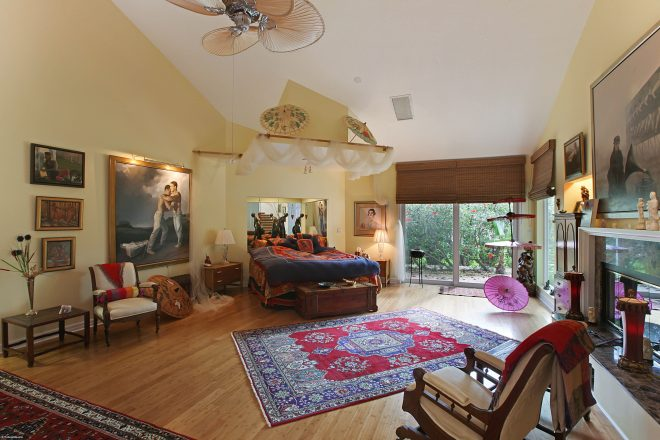 this creatively designed master bedroom has soaring ceilings