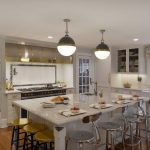 this expansive traditional kitchen features white painted