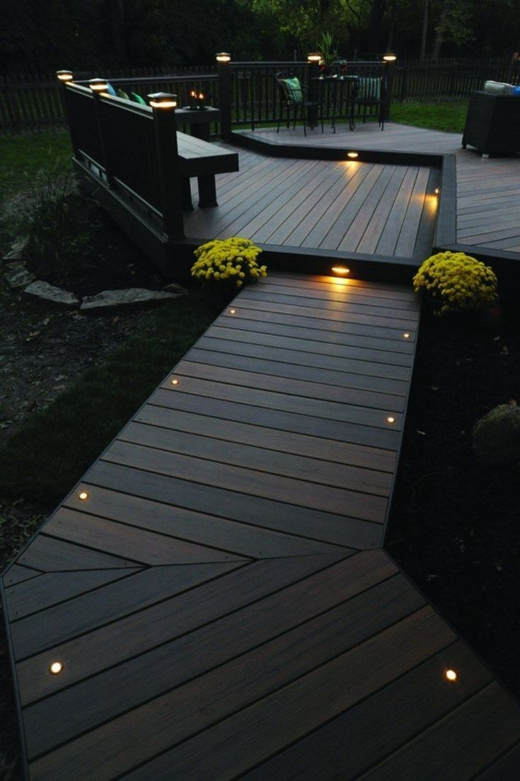 this more modern outdoor lighting makes a wood finish patio in a