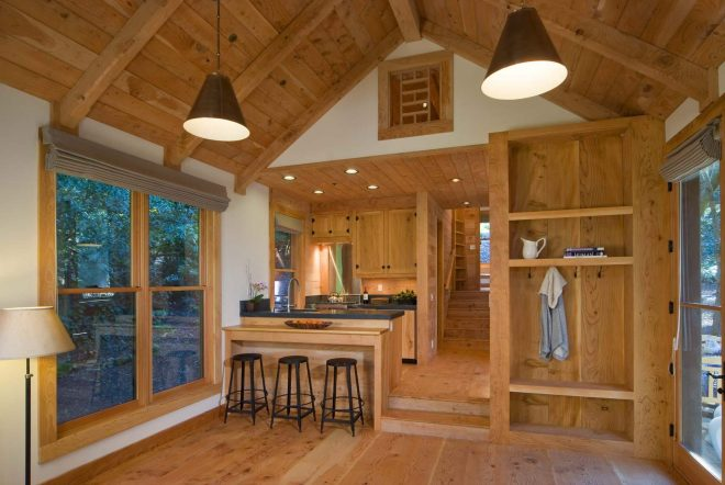 this rustic guest cabin features extensive custom interior woodwork