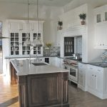 this vintage island shaped kitchen features a combination of