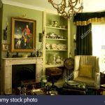 traditional green drawing room with antique furniture stock