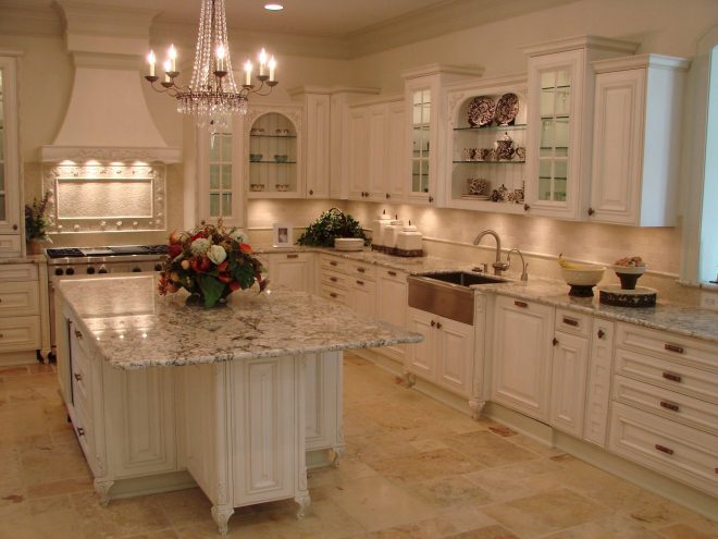traditional kitchen design with white cabinets and marble