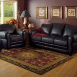traditional living room designed with black leather furniture and