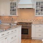 traditional white kitchen with blue azurite granite