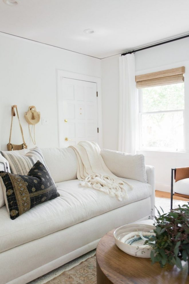 transitional white couch in a boho styled living room