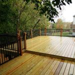treated lumber deck with western red cedar rail posts red