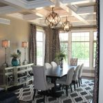 two globe chandeliers hang above the dining room table