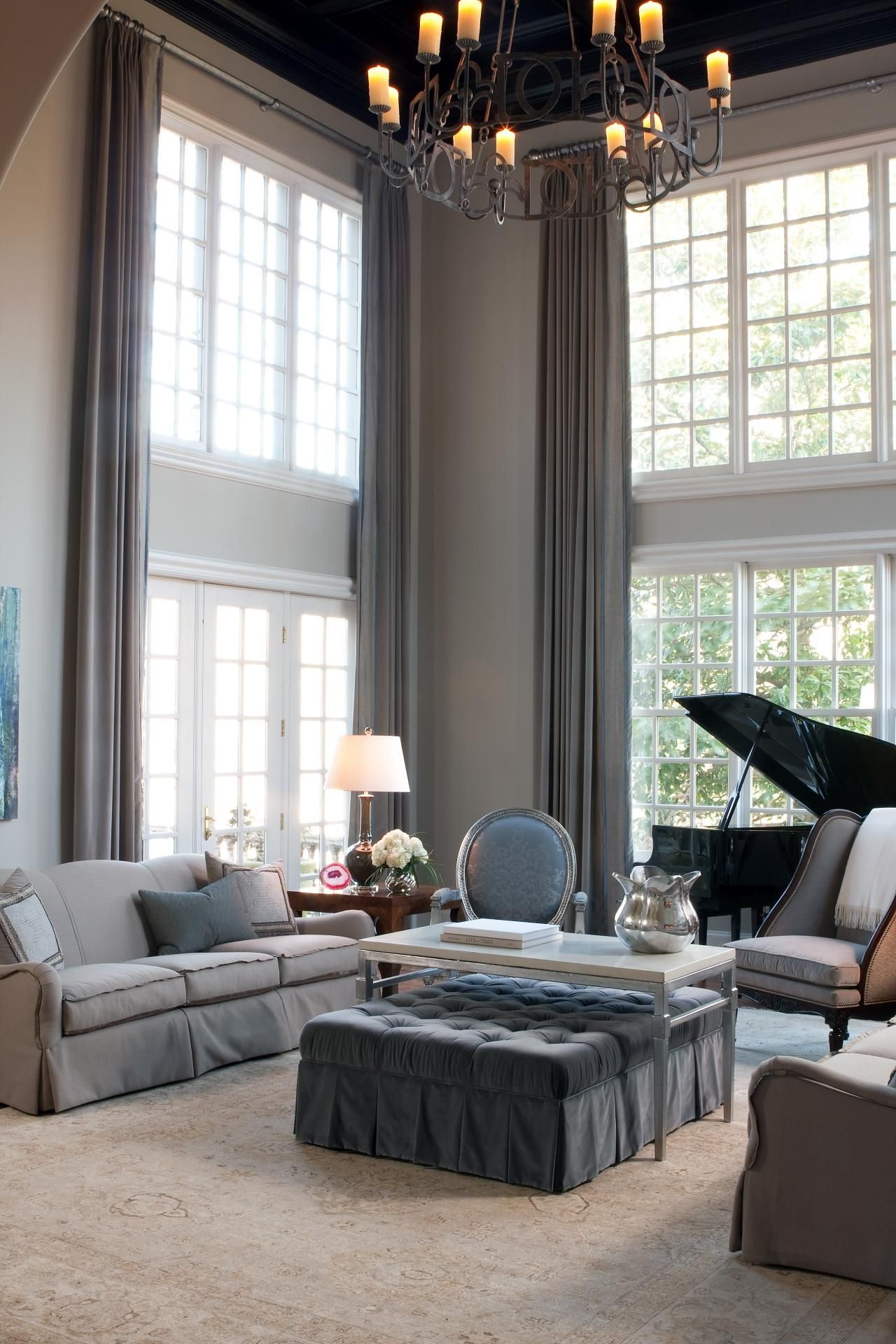 two story living room living room with two story window treatments