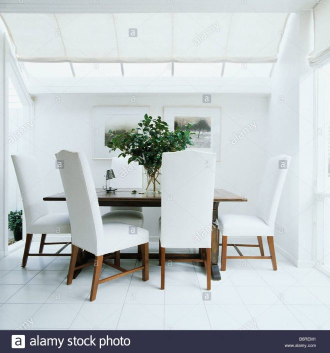 upholstered white dining chairs in all white modern dining