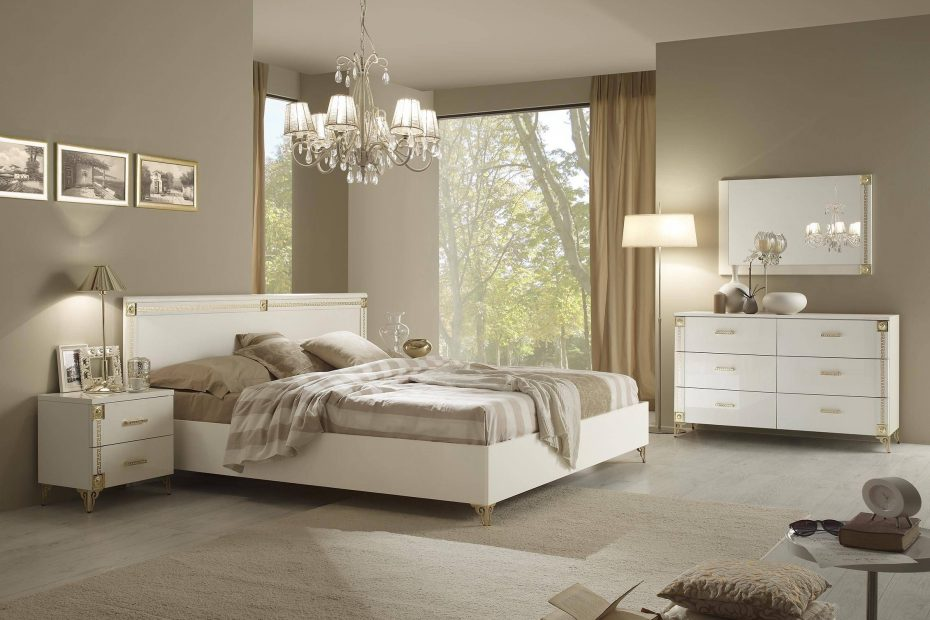 upscale classy white bedroom suite with stylish gold accents