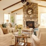 vaulted ceiling with wood beams natural stone fireplace