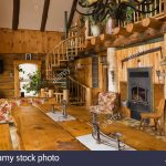 view the dining room table area inside a rustic cottage style stock