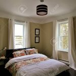 vintage decorator country bedroom with modern touches