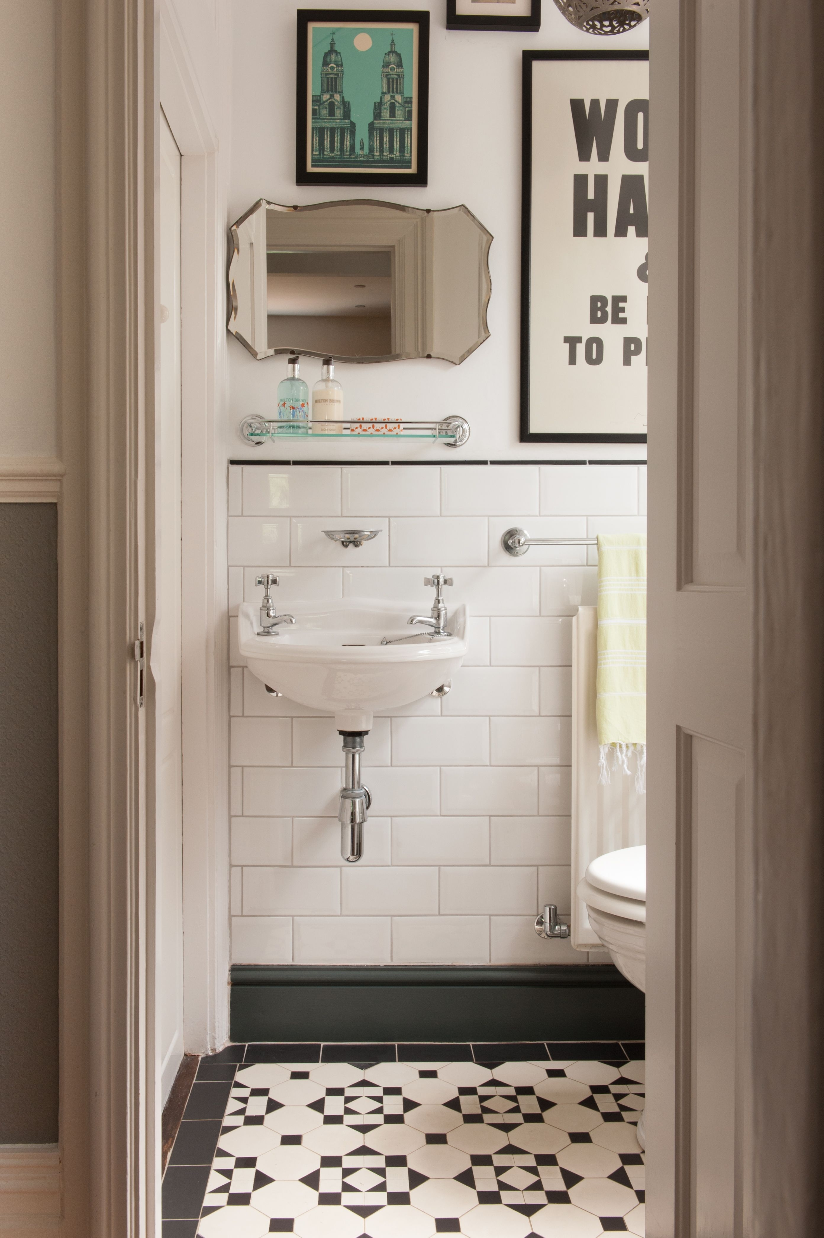 vintage style bathroom with black and white floor tile