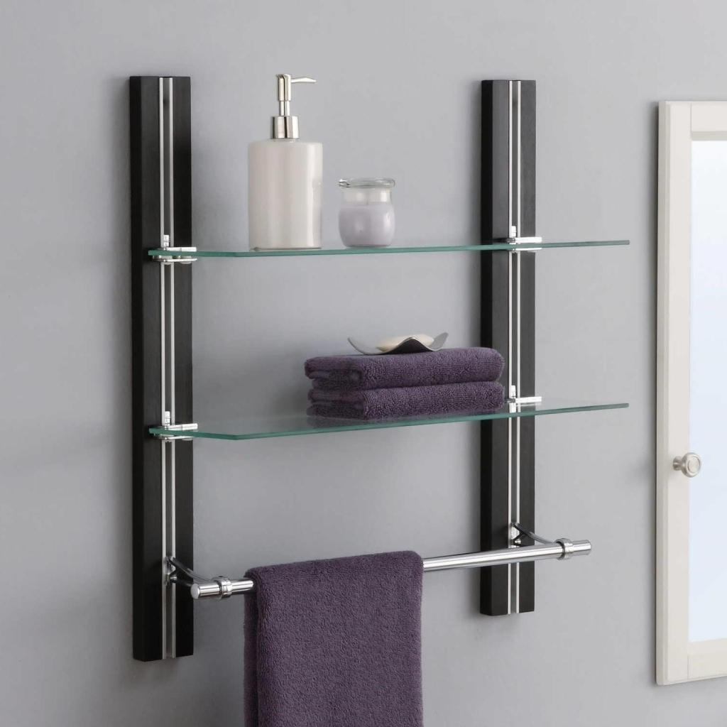 wall mounted cabinet using glass selves and metal towel bar for
