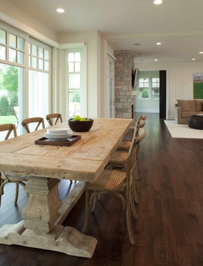 weathered trestle table in a light and airy dining room