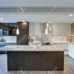 well appointed kitchen features a large kitchen island gray